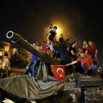 People stand on a Turkish army tank in Ankara, Turkey July 16, 2016.   REUTERS/Tumay Berkin
